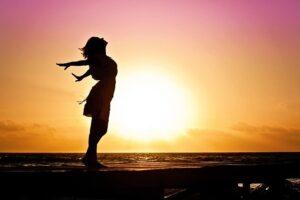 Woman breathing during sunrise